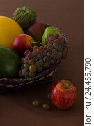 Купить «Exotic fruit basket, close-up, detail,», фото № 24455790, снято 20 февраля 2019 г. (c) mauritius images / Фотобанк Лори