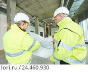 Купить «Construction builder workers», фото № 24460930, снято 10 декабря 2014 г. (c) Дмитрий Калиновский / Фотобанк Лори