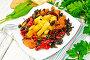 Кабачки с овощами по-гречески в тарелке на салфетке, фото № 24461058, снято 14 октября 2016 г. (c) Резеда Костылева / Фотобанк Лори