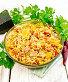 Рис с курицей и кабачками в сковороде на светлой доске, фото № 24461074, снято 26 октября 2016 г. (c) Резеда Костылева / Фотобанк Лори