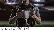 Купить «Composite image 3D of victorious rugby player holding trophy», фото № 24461970, снято 27 июня 2019 г. (c) Wavebreak Media / Фотобанк Лори