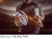 Купить «Composite image 3D of midsection of successful rugby player holding trophy and ball», фото № 24462594, снято 27 июня 2019 г. (c) Wavebreak Media / Фотобанк Лори