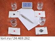 Купить «Колода игральных карт, авторучка, бумага и стопки с водкой на столе», фото № 24469262, снято 8 декабря 2016 г. (c) Максим Мицун / Фотобанк Лори