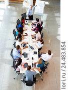 Купить «Businessman Addressing Meeting Around Boardroom Table», фото № 24483854, снято 20 октября 2013 г. (c) easy Fotostock / Фотобанк Лори
