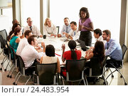 Купить «Businesswoman Addressing Meeting Around Boardroom Table», фото № 24483954, снято 20 октября 2013 г. (c) easy Fotostock / Фотобанк Лори