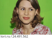 Купить «Woman, young, curls, smiles, portrait   Women portrait, 20-30 years, of course, naturalness, happiness, cheerfully, kindly, content, long-haired, gaze at the side, background green», фото № 24491562, снято 20 июля 2018 г. (c) mauritius images / Фотобанк Лори