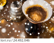 Купить «close up of coffeemaker and coffee pot», фото № 24492046, снято 1 декабря 2015 г. (c) Syda Productions / Фотобанк Лори