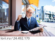 Купить «senior businessman with newspaper drinking coffee», фото № 24492170, снято 16 июля 2016 г. (c) Syda Productions / Фотобанк Лори