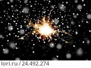 Купить «sparkler or bengal light burning over black», фото № 24492274, снято 18 ноября 2015 г. (c) Syda Productions / Фотобанк Лори