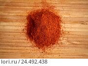 Купить «cayenne pepper or paprika powder on wood», фото № 24492438, снято 13 октября 2016 г. (c) Syda Productions / Фотобанк Лори