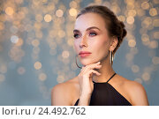 Купить «beautiful woman in black wearing diamond jewelry», фото № 24492762, снято 14 апреля 2016 г. (c) Syda Productions / Фотобанк Лори