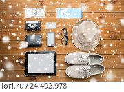 Купить «close up of gadgets and traveler personal stuff», фото № 24492978, снято 8 февраля 2016 г. (c) Syda Productions / Фотобанк Лори