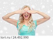 Купить «smiling young woman or teen girl covering her eyes», фото № 24492990, снято 13 февраля 2016 г. (c) Syda Productions / Фотобанк Лори