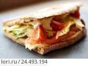 Купить «salmon panini sandwich on stone plate», фото № 24493194, снято 22 сентября 2016 г. (c) Syda Productions / Фотобанк Лори