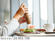 Купить «woman with salt shaker and salad at restaurant», фото № 24493198, снято 22 сентября 2016 г. (c) Syda Productions / Фотобанк Лори