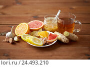 Купить «ginger tea with honey, citrus and garlic on wood», фото № 24493210, снято 13 октября 2016 г. (c) Syda Productions / Фотобанк Лори