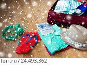 Купить «close up of travel bag with clothes and stuff», фото № 24493362, снято 9 февраля 2016 г. (c) Syda Productions / Фотобанк Лори