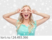 Купить «smiling young woman or teenage girl showing peace», фото № 24493366, снято 13 февраля 2016 г. (c) Syda Productions / Фотобанк Лори