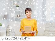Купить «happy asian young woman with parcel box at home», фото № 24493414, снято 9 марта 2016 г. (c) Syda Productions / Фотобанк Лори