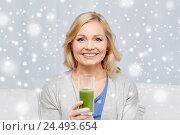 Купить «happy woman drinking green juice or shake at home», фото № 24493654, снято 27 ноября 2015 г. (c) Syda Productions / Фотобанк Лори
