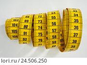 Купить «Tape measure, yellow,», фото № 24506250, снято 13 ноября 2009 г. (c) mauritius images / Фотобанк Лори