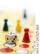 Купить «Play, 'Mensch ärgere dich nicht' game, cube, field, close-up,», фото № 24525662, снято 21 августа 2018 г. (c) mauritius images / Фотобанк Лори