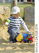 Купить «Boy, sandbox, play, trucks,», фото № 24528574, снято 21 октября 2009 г. (c) mauritius images / Фотобанк Лори