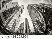 Купить «Вид снизу на высотные башни международного делового центра «Москва-Сити». Монохромное изображение», фото № 24553950, снято 22 марта 2019 г. (c) Сергей Цепек / Фотобанк Лори