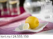 Купить «Porcelain peel, lemon, water glasses, background blur,», фото № 24555150, снято 25 июня 2008 г. (c) mauritius images / Фотобанк Лори