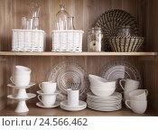 Купить «Glasses, dishes, cupboard, baskets,», фото № 24566462, снято 21 сентября 2018 г. (c) mauritius images / Фотобанк Лори