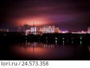 Ночное фото современного туристического города - Хэйхэ (Китай) с красивым оранжево-фиолетовым небом (2013 год). Стоковое фото, фотограф Евгений Беляев / Фотобанк Лори