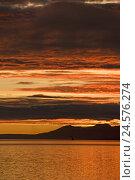 Купить «Argentina, Ushuaia, beagle channel, sunrise, morning, morning mood, scenery, mountains, heavens, clouds, waters, reflexion,», фото № 24576274, снято 4 октября 2010 г. (c) mauritius images / Фотобанк Лори