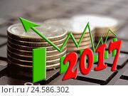 Купить «2017 год на фоне столбиков монет», фото № 24586302, снято 12 февраля 2016 г. (c) Сергеев Валерий / Фотобанк Лори