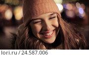 Купить «happy young woman in winter hat at christmas», видеоролик № 24587006, снято 8 декабря 2016 г. (c) Syda Productions / Фотобанк Лори