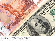 Купить «Купюры, пять тысяч и сто долларов», эксклюзивная иллюстрация № 24588162 (c) Юрий Морозов / Фотобанк Лори