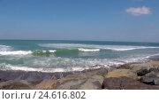 Купить «Deserted ocean stony coastline with foaming waves», видеоролик № 24616802, снято 12 ноября 2016 г. (c) Гурьянов Андрей / Фотобанк Лори