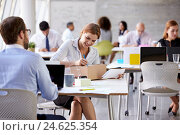Купить «Businesswoman In Office Addressing Package For Shipping», фото № 24625354, снято 11 октября 2015 г. (c) easy Fotostock / Фотобанк Лори
