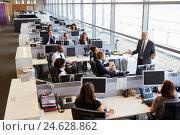 Купить «Senior male manager addressing workers in open plan office», фото № 24628862, снято 24 июня 2015 г. (c) easy Fotostock / Фотобанк Лори