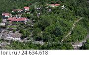 Купить «Небольшая горная деревня у дороги на склонах холмов в Черногории», видеоролик № 24634618, снято 29 ноября 2016 г. (c) Кекяляйнен Андрей / Фотобанк Лори