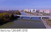 Купить «Aerial shot of the russian south city - Krasnodar. The river Kuban. 4K», видеоролик № 24641010, снято 8 декабря 2016 г. (c) ActionStore / Фотобанк Лори