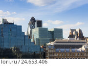 Купить «The Gherkin' building in the financial district on the Thames, GB, London,», фото № 24653406, снято 15 июня 2010 г. (c) mauritius images / Фотобанк Лори