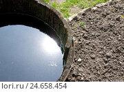Купить «Rain tonne with water, patch, ground,», фото № 24658454, снято 22 ноября 2010 г. (c) mauritius images / Фотобанк Лори