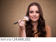 Купить «Beautiful woman applying make-up in beauty concept», фото № 24668202, снято 26 августа 2016 г. (c) Elnur / Фотобанк Лори