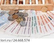 Купить «Деньги с деревянными счетами», фото № 24668574, снято 14 декабря 2016 г. (c) Элина Гаревская / Фотобанк Лори