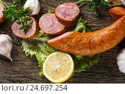 Натюрморт с копченой колбасой. Стоковое фото, фотограф Igor Sirbu / Фотобанк Лори