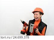 Веселая женщина с электрическими строительными инструментами. Стоковое фото, фотограф VIACHESLAV KRYLOV / Фотобанк Лори