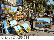 Купить «Paintings at Yerevan Vernissage, a large open-air market situated along Aram and Buzand street, Yerevan, Armenia, Eurasia.», фото № 24699614, снято 1 октября 2016 г. (c) age Fotostock / Фотобанк Лори