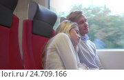 Купить «Sleeping young couple in a train», видеоролик № 24709166, снято 17 июня 2019 г. (c) Raev Denis / Фотобанк Лори
