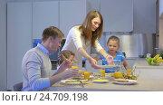 Купить «Happy family with children at home», видеоролик № 24709198, снято 16 июля 2019 г. (c) Raev Denis / Фотобанк Лори
