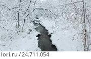Купить «Small creek in winter snowy forest among snow banks», видеоролик № 24711054, снято 7 ноября 2016 г. (c) Serg Zastavkin / Фотобанк Лори